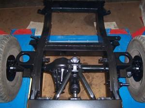 Detailfoto van het chassis de achteras en niveauregeling.